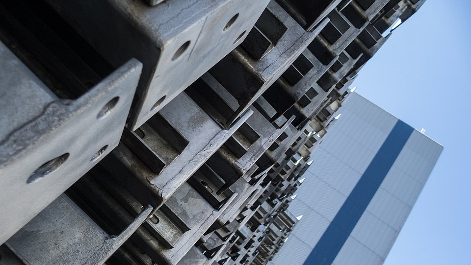 Construction material steel: steel girders in front of steel structure